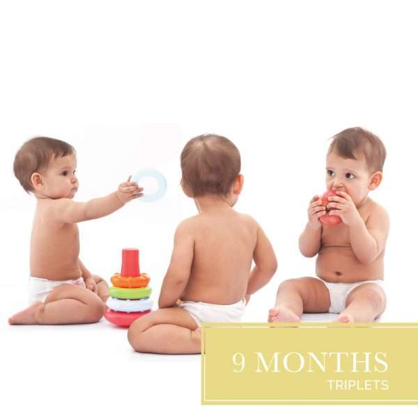 Triplet babies wearing diapers playing with toys