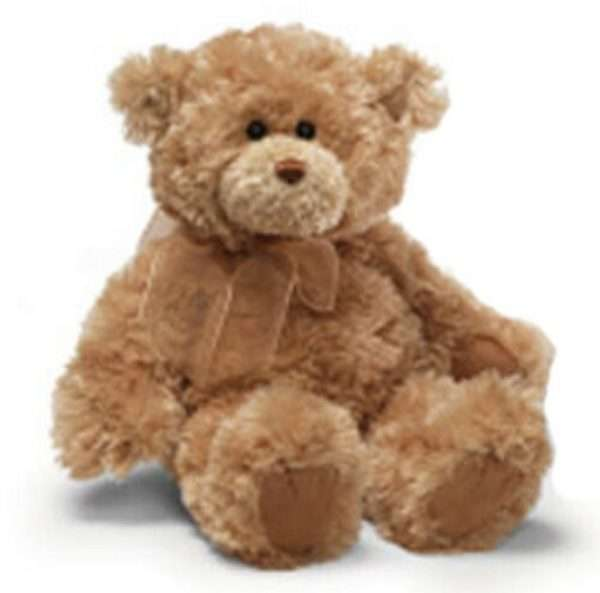 Brown teddy bear with bow on neck