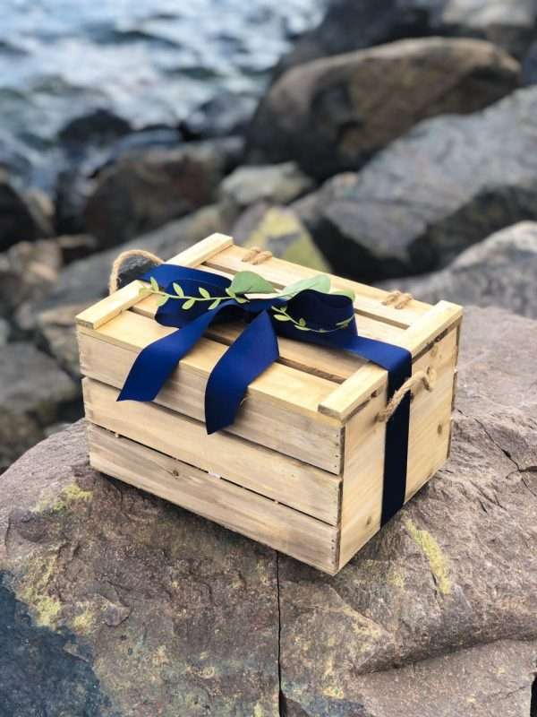 Create gift on stone for baby with blue bow