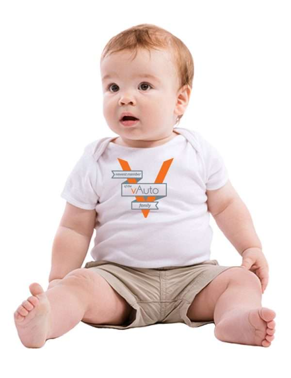 baby in white tshirt with logo