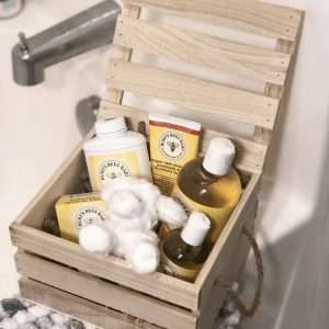 Burt's Bees baby products in wooden crate gift box