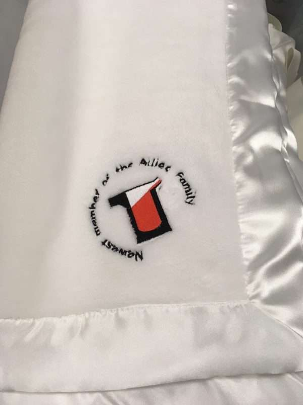company logo on blanket with satin trim
