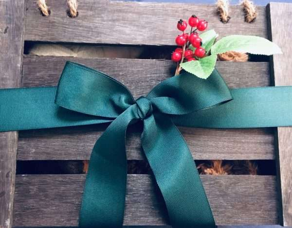 holiday crate wrapped in bow and holly