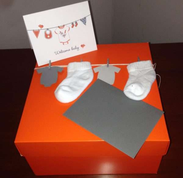 Orange box with baby socks and gift card