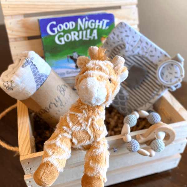 Wooden crate with baby swaddle book plush toy and mroe