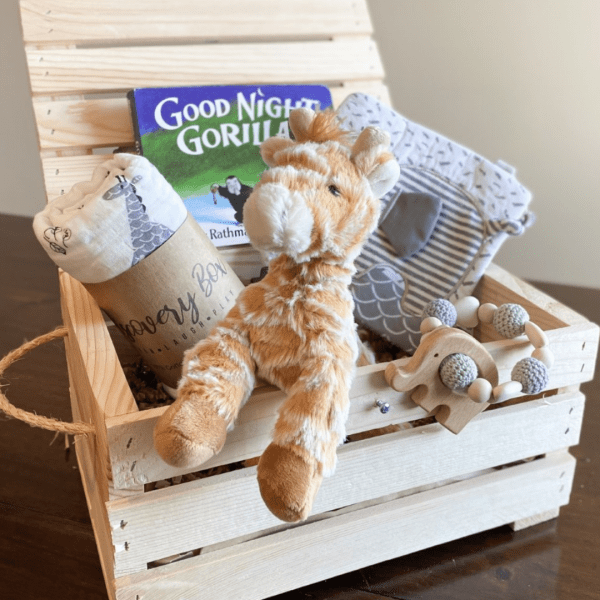 wooden box with baby toys inside