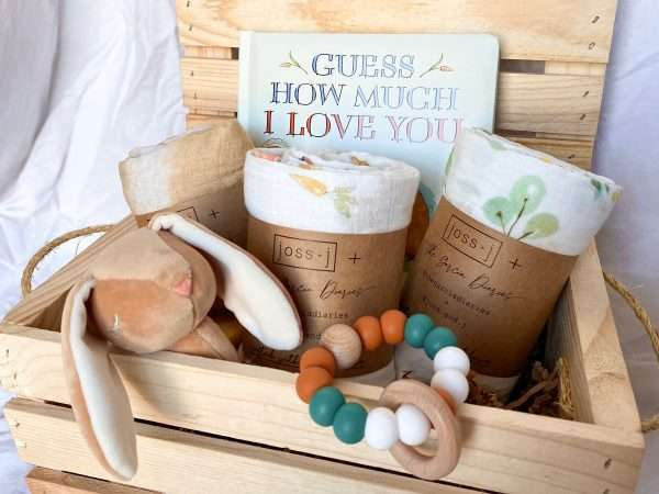 wooden crate with baby swaddles bunny rattle and board book for luxury baby gift