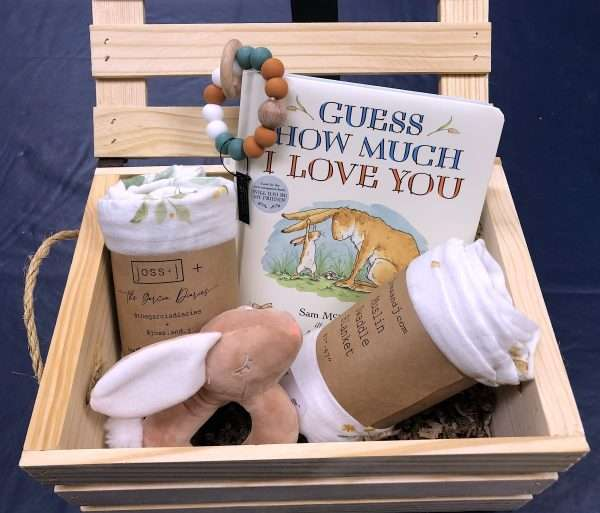 wooden box filled with baby goodies