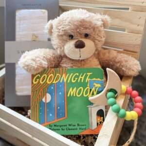 wooden crate with teddy bear goodnight moon book and other baby gifts